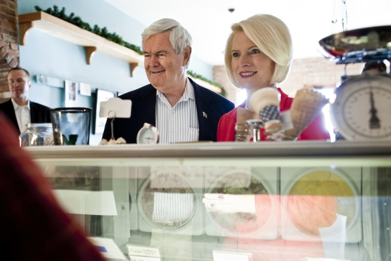 <p>Newt Gingrich, former Speaker of the House, center, and his wife Callista, right, consider their ice cream options before leaving a campaign stop at Elly's Tea in Muscatine, Iowa on the day of the Iowa Caucus.</p>