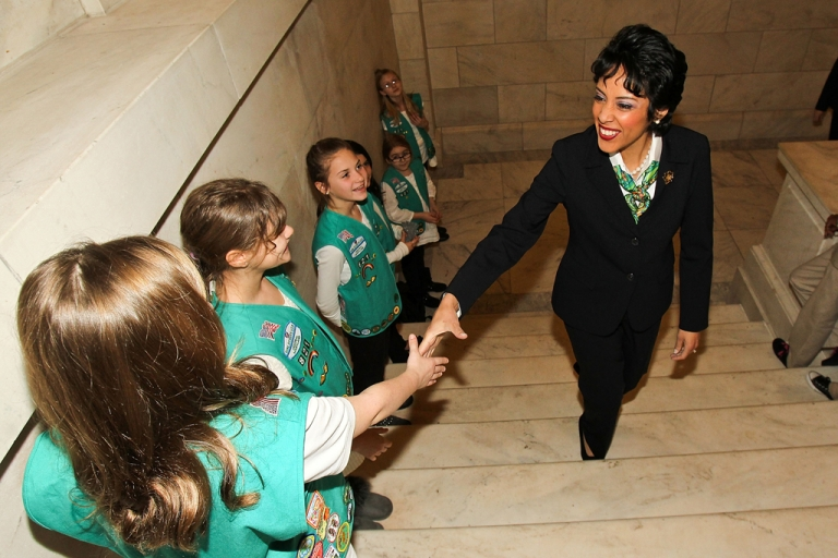 <p>Anna Maria Chavez, Chief Executive Officer of Girl Scouts of the USA, is greeted by area Girl Scouts as she arrives at Girl Scouts At 100: The Launch of ToGetHerThere at the Capitol Hill Cannon House Office Building Caucus Room on February 1, 2012 in Washington, DC.</p>