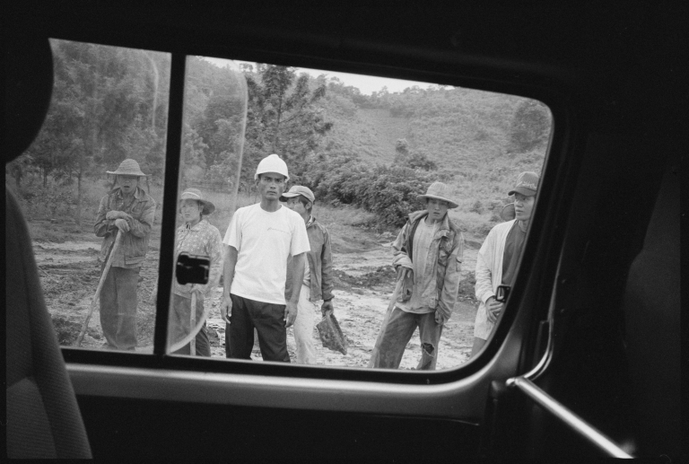 <p>An engineer and Burmese laborers on the gas and oil pipeline that carves its way from Kunming in China to the Indian Ocean on the coast of Burma. Built and designed by the China National Petroleum Corporation, the pipeline will be 2800 km long once complete.</p>