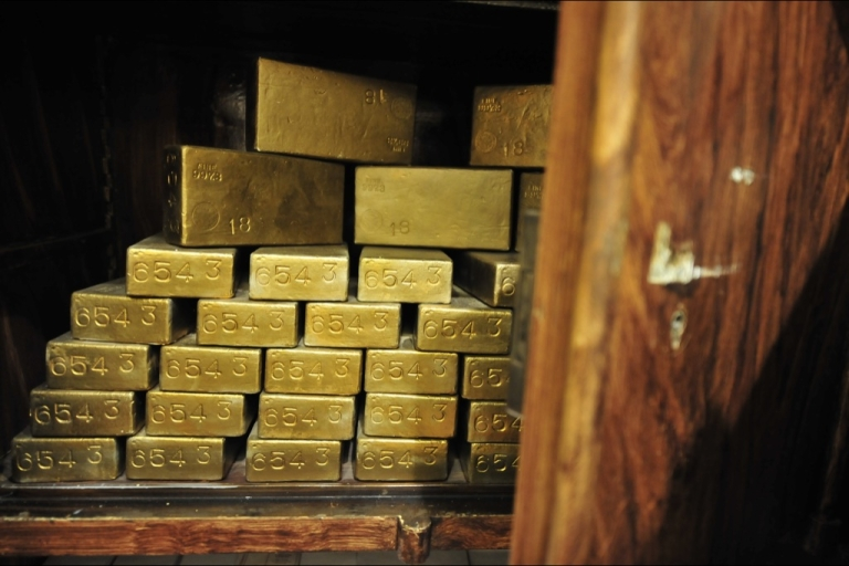 <p>Gold ingots in an antique safe, about 100 years old, shown at the
