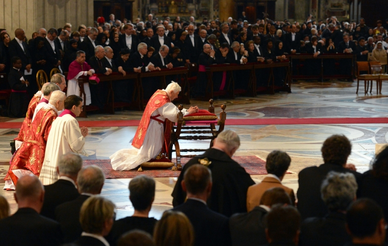 <p>Pope Benedict XVI (C) prays during the Celebration of the Lord's Passion on Good Friday on April 6, 2012 St Peter's basilica at The Vatican. Christians mark the crucifixion of Jesus Christ on Friday in a series of ceremonies culminating on Sunday, when they celebrate Christ's resurrection.</p>