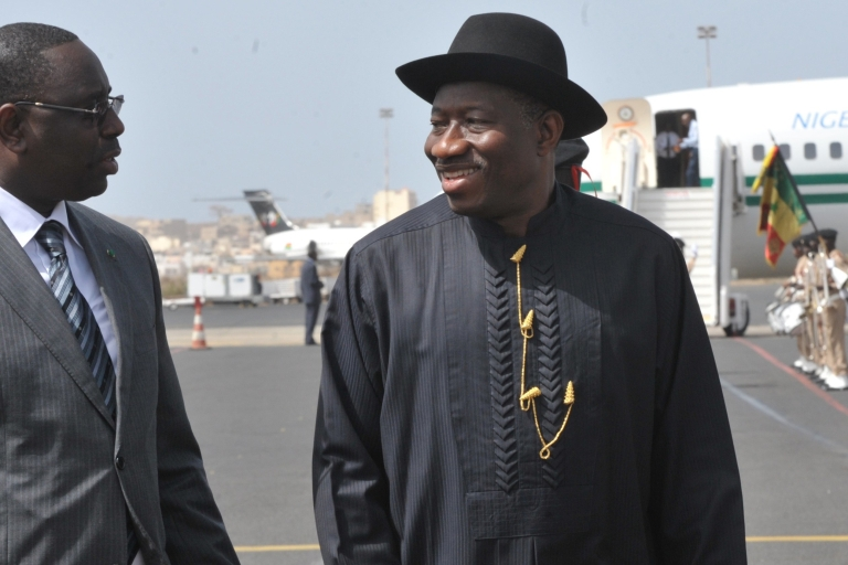 <p>Nigerian President Goodluck Jonathan, right, with Senegalese President Macky Sall, upon his arrival on May 3, 2012 at Dakar's airport.</p>
