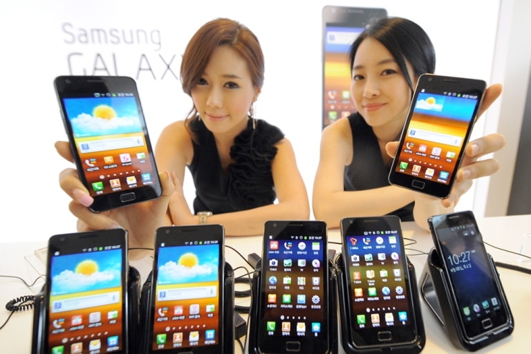 <p>Models pose with Samsung Galaxy S2s during its launch in Seoul, Korea on April 28, 2011. The Galaxy S2 runs on the Android operating system, which just racked up its 10 billionth app download for Google.</p>