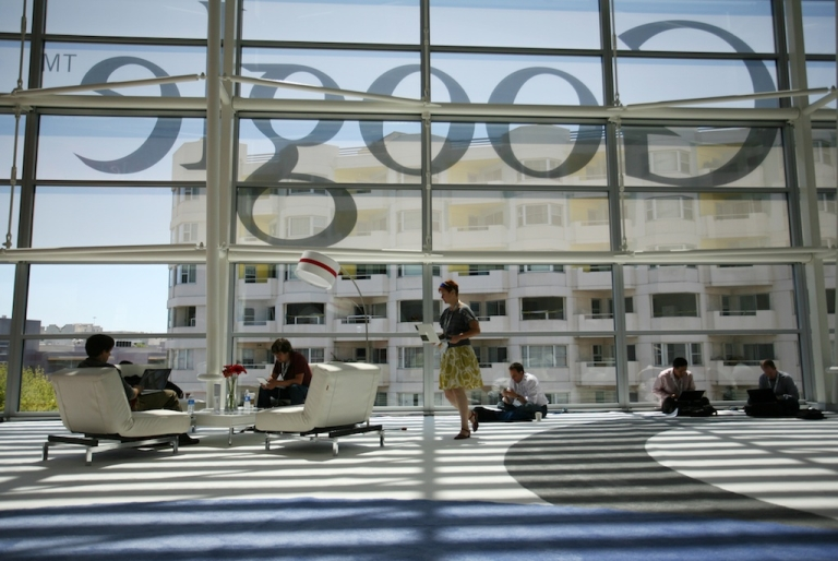 <p>A Google logo is seen through the window in San Francisco during Google's annual developer conference on June 28, 2012 in California.</p>