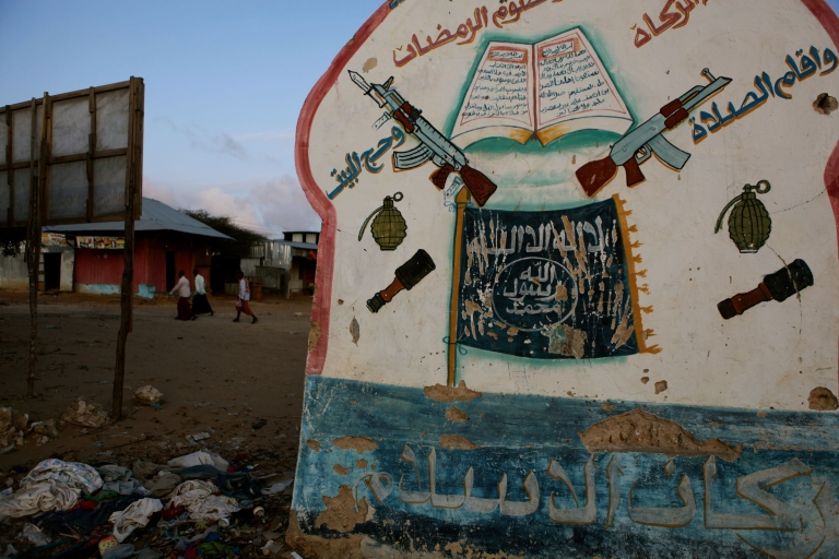 <p>On the road to Afgoye, a signpost is evidence that Al Shabaab once controlled this area.</p>