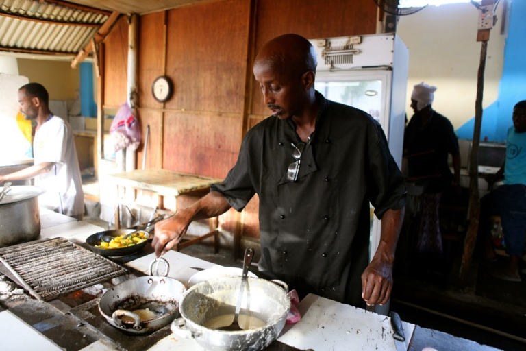 <p>British-trained Somali chef Ahmed Jama prepares food in the open kitchen at his Village Restaurant in Mogadishu.</p>