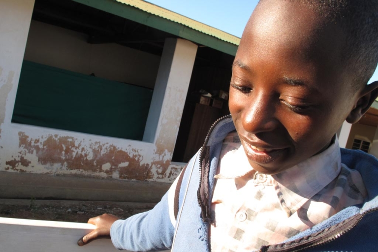 <p>Frederick Mgona, 15, walks outside Tamwat Hospital in Mjombe, Tanzania, after being circumcised. He said the anticipation of the surgery was worse than the operation itself. An older cousin had brought him and his friend in for circumcision during a USAID-funded campaign.</p>