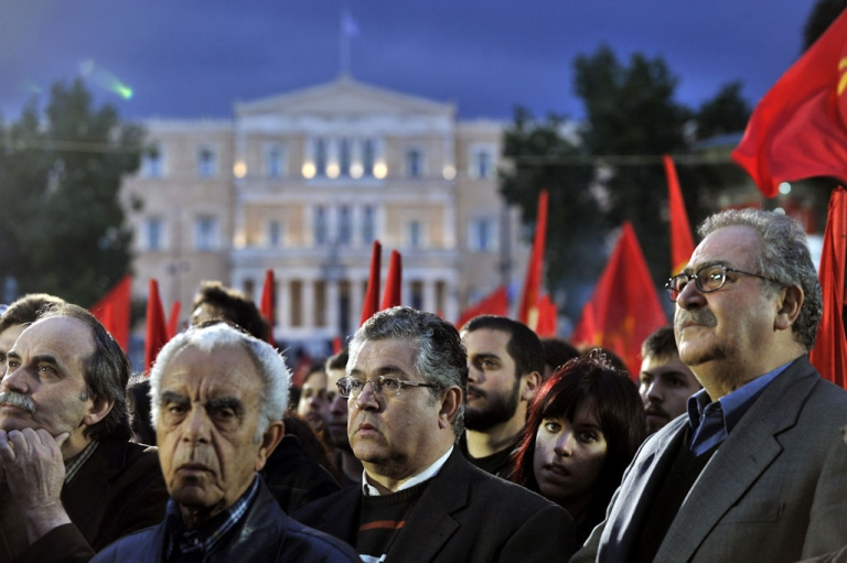 <p>Pro-Communist Party Greeks participate in a protest rally against austerity measures at central Athens square on April 18, 2011.</p>