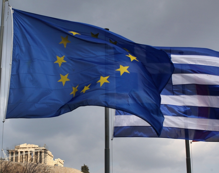 <p>The EU and Greek flags fly in front of the Parthenon in Athens, Greece on February 17, 2012.</p>