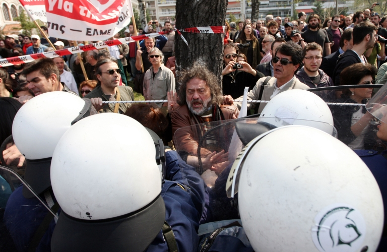 <p>Demonstrators scuffle with riot police in Athens during Greece's Independence Day celebrations on March 25.</p>