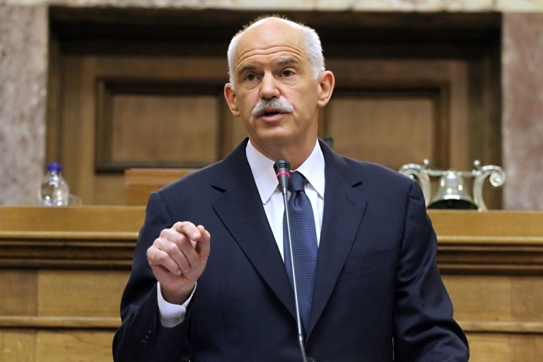 <p>Greek Prime Minister George Papandreou gestures during his speech to the Panhellenic Socialist Movement (PASOK) parliamentary group at the Greek parliament in Athens on October 31, 2011. Papandreou called for a confidence vote and a referendum to approve last week's EU summit deal.</p>