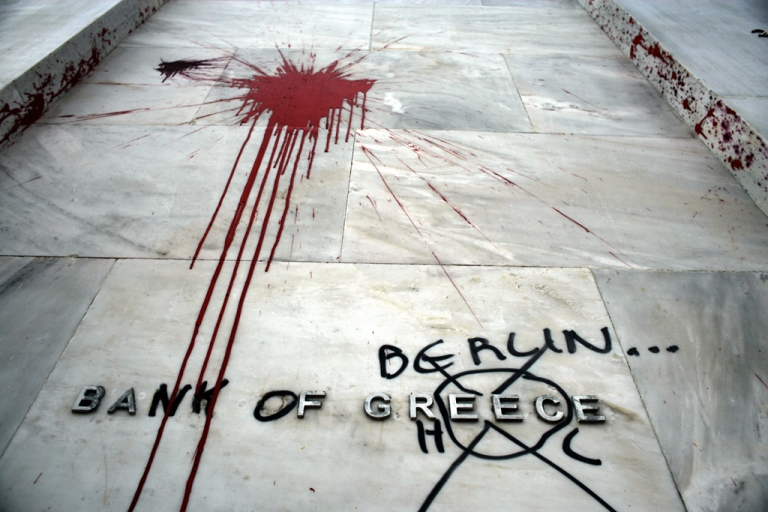 <p>The Headquarters of the Bank of Greece are vandalized following violent protests which took place against the Government's austerity plans, February 13, 2012 in Athens, Greece. Greece's economic woes have fostered resentment toward Germany, the primary money lender in the Greek bailouts.</p>