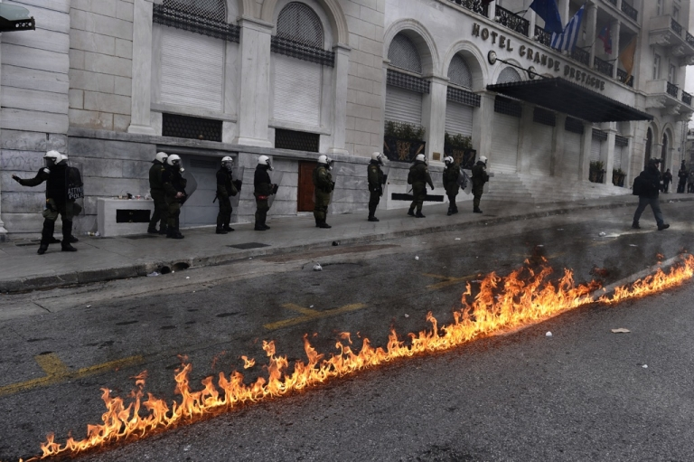 <p>Riot police clash with protesters during a 48-hour general strike in Athens on February 10, 2012. Greek protesters threw stones and firebombs at riot police who responded with tear gas in Athens on February 10 as clashes erupted on the sidelines of a protest against new austerity cuts.</p>