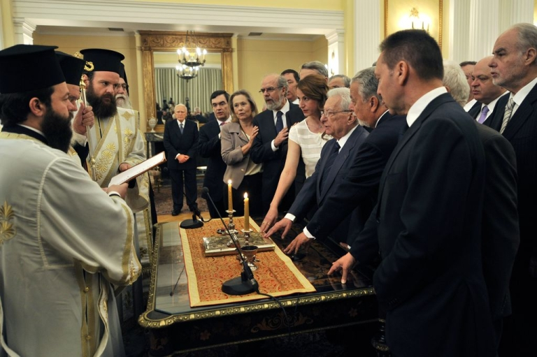 <p>Greece's newly appointed caretaker cabinet is sworn in during a ceremony with church leaders at the presidential palace in Athens, May 17, 2012.</p>