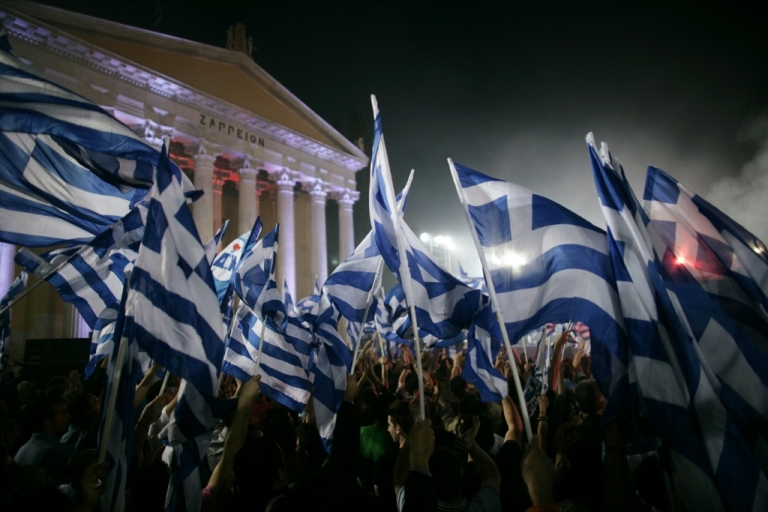 <p>Supporters wave flags as Greek New Democracy leader Antonis Samaras (not pictured) addresses a pre-election rally, on May 03, 2012 in Athens, Greece. The country held an election May 6, with poll results showing the center-right New Democracy and socialist PASOK parties losing their long-held political dominance.</p>