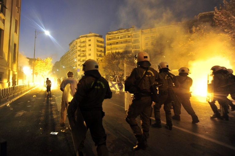 <p>Anti-riot police clashes with demonstrators during a protest in Thessaloniki, northern Greece on September 10, 2011. Clashes broke out between police and demonstrators today as thousands took to the streets of Greece's second city of Thessaloniki in a mass protest against austerity measures.</p>