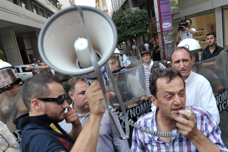 <p>Greeks fear government austerity is damaging their society.</p>