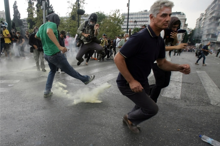 <p>In another sign of major discord in the EU, demonstrators in Greece clashed with riot police during a protest against a visit by Germany's Chancellor Angela Merkel in Athens, October 9, 2012. The EU was awarded the Nobel Peace Prize this morning, but some don't see why.</p>
