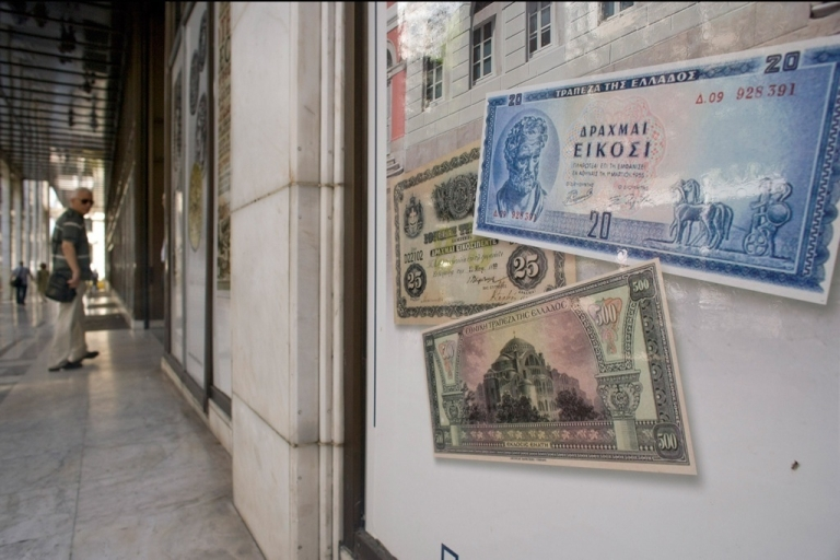 <p>Replica drachma notes on display outside a bank on June 14, 2012 in Athens, Greece.</p>