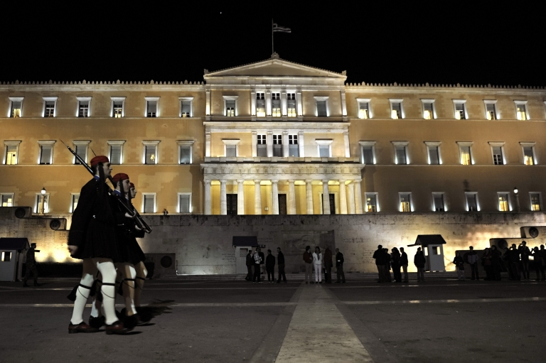 <p>Greek presidential guards arrive for the changing of the guard in front of the Greek Parliament in Athens on Nov. 2, 2011.</p>