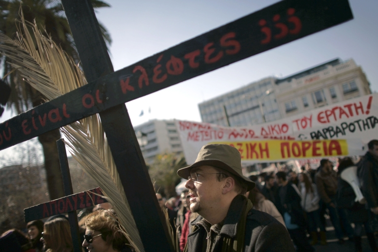 <p>Greeks fear that a second EU-IMF rescue package will entail further austerity and wage cuts they say they cannot afford.</p>
