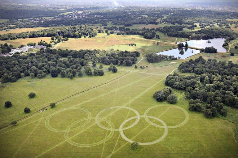 <p>An aerial view of Olympic Rings cut into the grass of Richmond Park, London, England.</p>