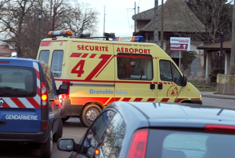 <p>An airport security van leaves the site of a small plane crash in Saint-Geoirs, on January 5, 2013. Five people died when their private plane crashed a few moments after taking off from the Grenoble airport in southeastern France, local police said.</p>