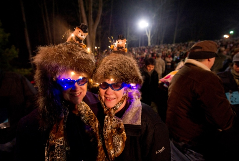 <p>Shirley Moffat and Joanne Alexander of Pittsburgh wait for Punxsutawney Phil to come from his den at 126th annual Groundhog Day festivities on Feb. 2, 2012 in Punxsutawney, Pa.</p>