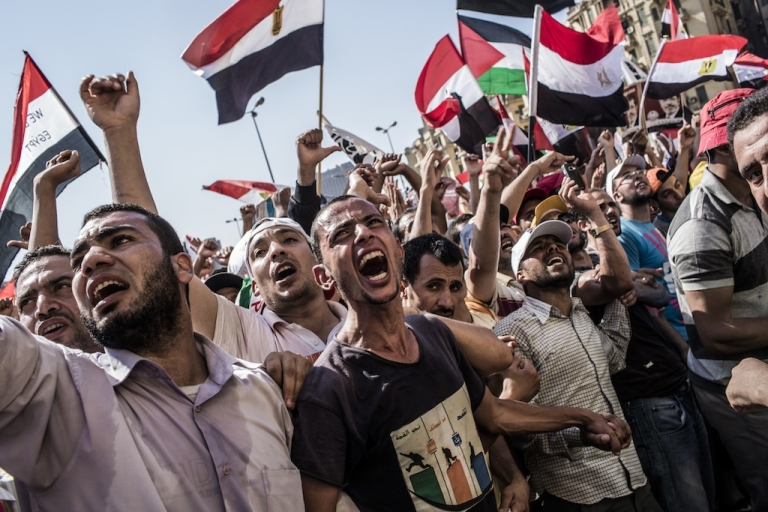 <p>Egyptians gather to celebrate the election of their new president Mohamad Morsi in Tahrir Square on June 24. The elation might be short-lived, however, as Egypt faces uncertainty about the future of the presidency.</p>