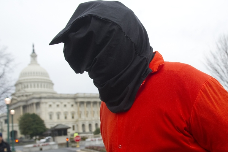 <p>A protester dressed like a Guantanamo prisoner demonstrates against holding detainees at the US military prison in Guantanamo Bay during in front of the US Capitol in Washington, DC, on Jan. 11 — the 10th anniversary of the arrival of the first group of detainees to be held at the prison.</p>