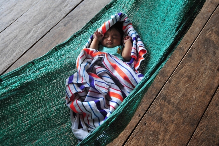 <p>A baby sleeps in a hammock in Rio Dulce, about 110 miles northeast of Guatemala City. Guatemala is one of the countries that are part of U.S. President Barack Obama's Global Health Initiative.</p>