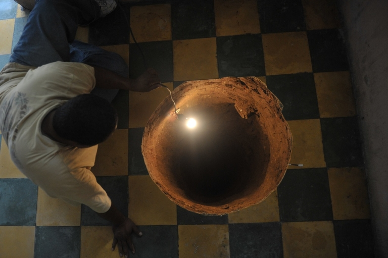 <p>A man inspects a sinkhole formed in a house in Guatemala City on July 19, 2011. A Florida man was trapped in a huge sinkhole late on Feb 28, authorities report.</p>
