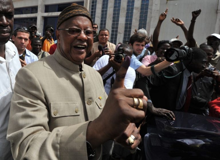 <p>Guinea-Bissau presidential candidate and Prime Minister Carlos Gomes Junior shows an inked finger after casting his vote in the first round of presidential elections on Mar. 18.  He is now missing after his home was attacked during an attempted coup.</p>