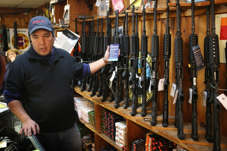 <p>Guns fly off the shelf Dec. 17, 2012 in Tinley Park, IL.</p>