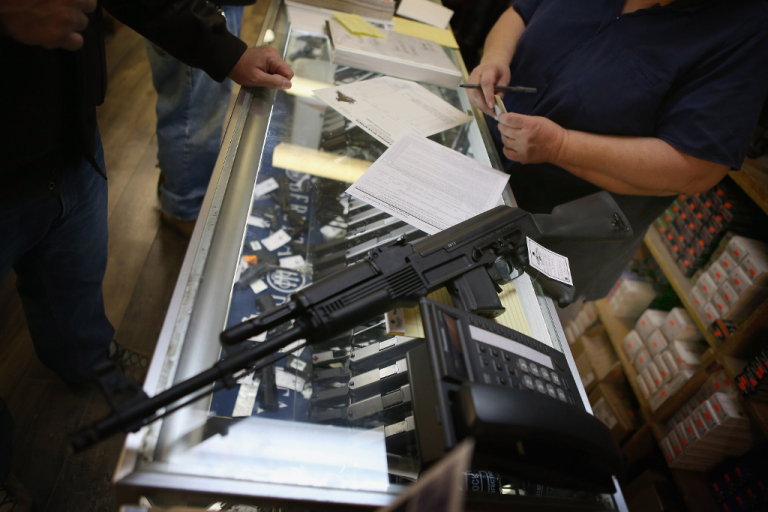 <p>An assault rifle is purchased on Dec. 17, 2012 in Tinsley Park, IL.</p>