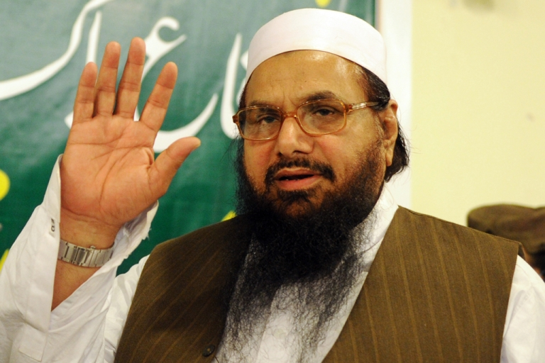 <p>Hafiz Saeed, the founder of Lashkar-e-Taiba, gestures as he leaves after a news conference in Rawalpindi on April 4, 2012. Pakistani Prime Minister Yousaf Raza Gilani said Saeed was an