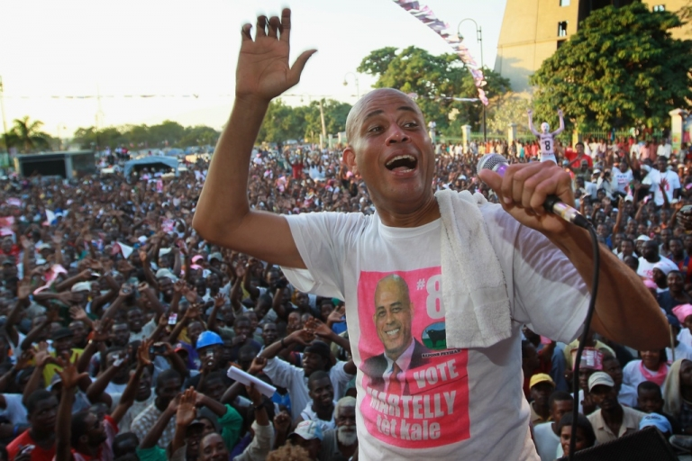 <p>Haitian presidential candidate, Michel Martelly speaks to his supporters during a campaign rally on Nov. 25, 2010, in Port-au-Prince.</p>