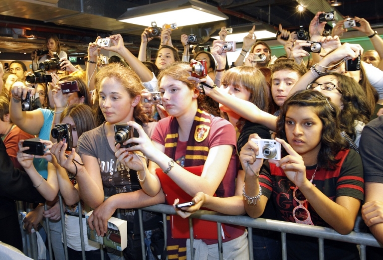 <p>Fans took pictures during a meeting with the