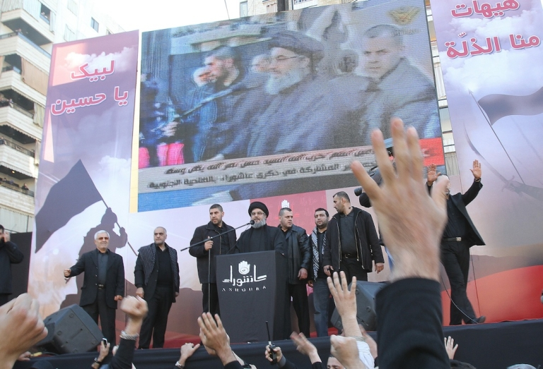 <p>Lebanon's Hezbollah chief Hassan Nasrallah makes his first public appearance since 2008 before a frenzied crowd in the southern suburbs of Beirut on December 6, 2011.</p>