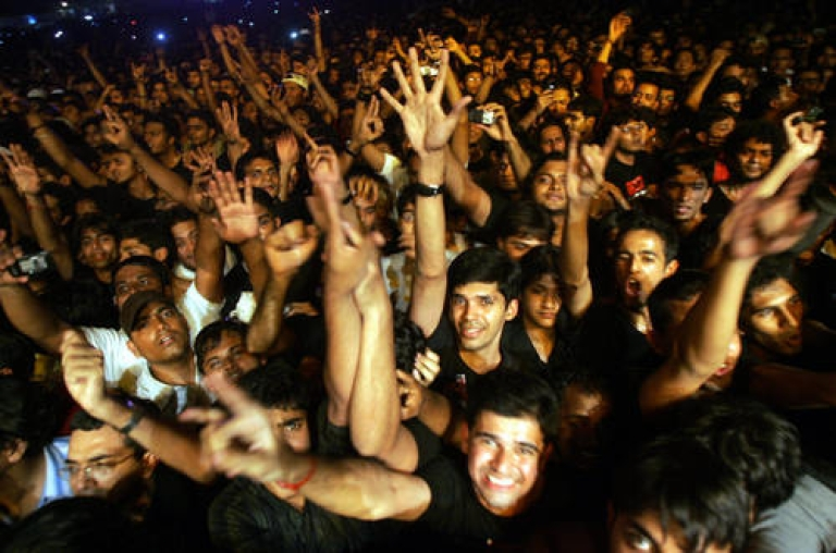 <p>In this picture taken 16 March 2007, Indian fans of British rock group Iron Maiden shout as their heroes perform during a concert in Bangalore.</p>