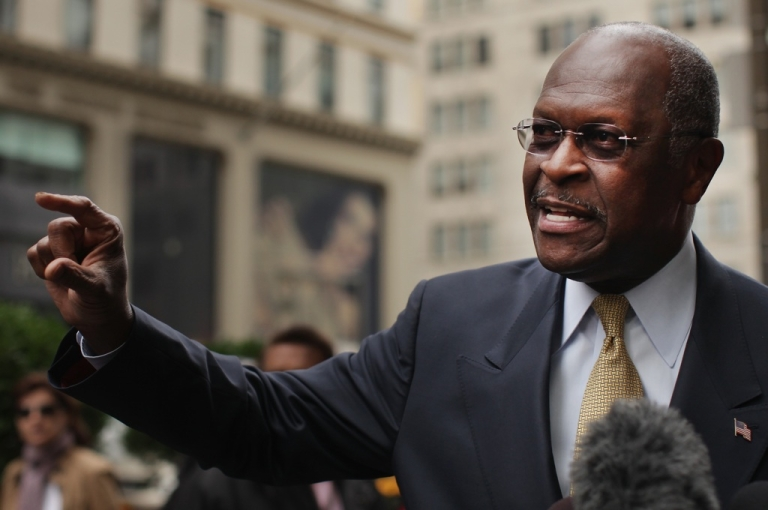 <p>Republican presidential candidate Herman Cain speaks to the media outside of Trump Towers before a scheduled appearance with real estate mogul Donald Trump on October 3, 2011, in New York City.</p>
