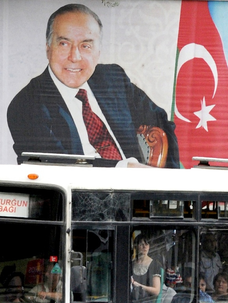 <p>A huge poster of former Azerbaijian President Heydar Aliyev in the country's capital Baku on May 22, 2012.</p>