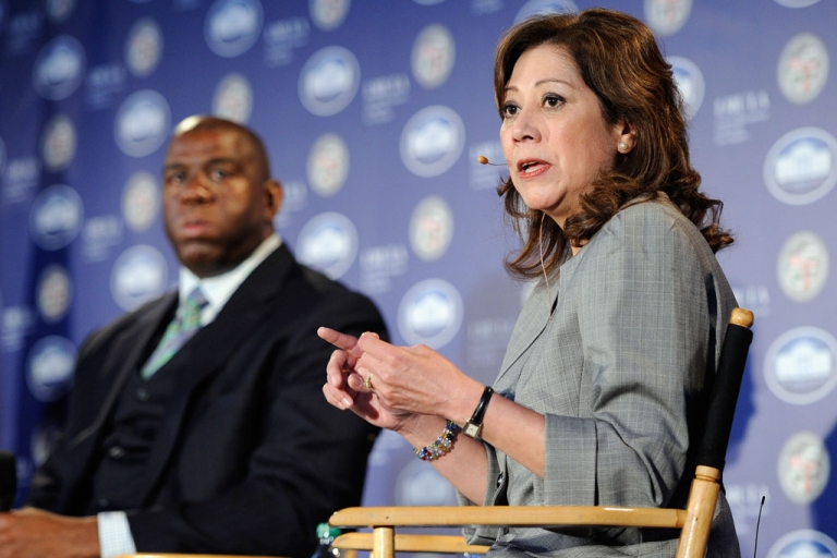 <p>US Labor Secretary Hilda Solis speaks during a Urban Economic Forum co-hosted by White House Business Council and US Small Business Administration at Loyola Marymount University on March 22, 2012 in Los Angeles, California. To her left is LA Lakers legend Magic Johnson.</p>