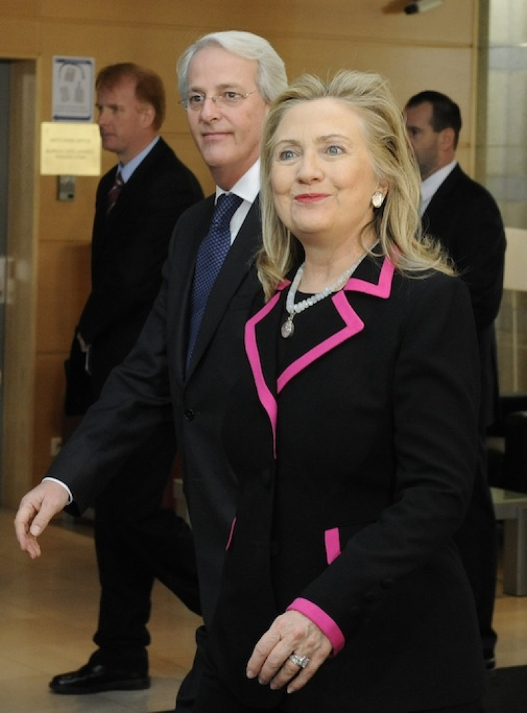 <p>US Secretary of State Hillary Clinton (R) arrives with US NATO Ambassador Ivo Daalder on December 4, 2012 at North Atlantic Treaty Organization (NATO) headquarters in Brussels.</p>