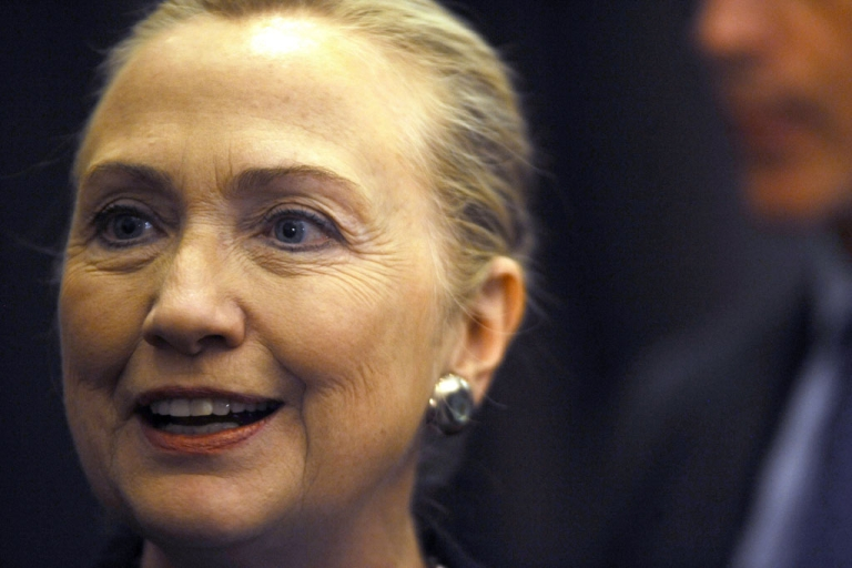 <p>US Secretary of State Hillary Clinton poses after delivering a speech on August 8, 2012 at the University of the Western Cape in Cape Town. Clinton urged South Africa to build on icon Nelson Mandela's legacy and flex its growing influence on the global sticking points of Syria, Iran and Zimbabwe.</p>