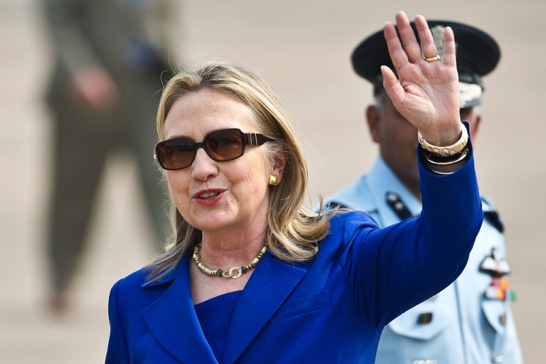 <p>US Secretary of State Hillary Clinton waves on her arrival at Palam Air Force Station in New Delhi on May 7, 2012.</p>