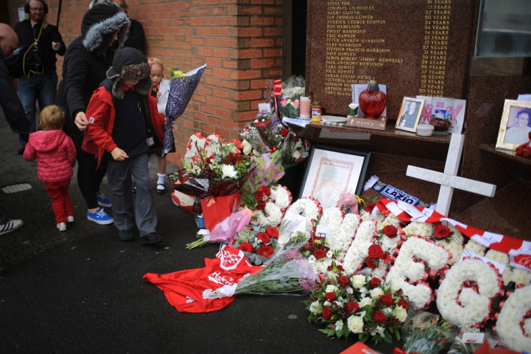 <p>Children lay floral tributes to the victims of the Hillsborough disaster at the Hillsborough memorial at Anfield stadium after the publication of the independent report into the 1989 Hillsborough Disaster on September 12, 2012 in Liverpool, England. Ninety-six fans were crushed to death on overcrowded terraces at Hillsborough football stadium,  Sheffield, during the FA Cup semi-final on April 15 1989.</p>
