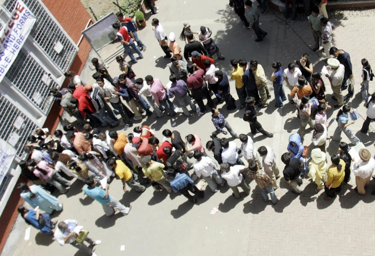 <p>NEW DELHI, INDIA:  An Indian student stand in a queue to get admission forms at the Hindu College in New Delhi, 01 June 2005.  Thousands of students from all over India, who succeeded in their higher secondary examinations, seek admission in the prestigious Delhi University which offers more than 90,000 seats.</p>