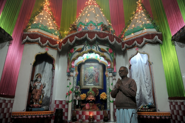 <p>Hindus make up 2.5 percent of the 174 million people living in Pakistan, and more than 90 percent of them live in Sindh province. Here, a chief priest worships at a temple in Karachi.</p>