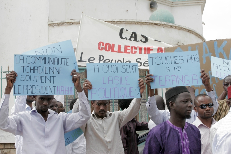 <p>Supporters of Chad's deposed leader Hissene Habre hold a demonstration against his extradition in Dakar on July 10, 2011. Senegal has refused to send the former dictator to Belgium or Chad to stand trial.</p>